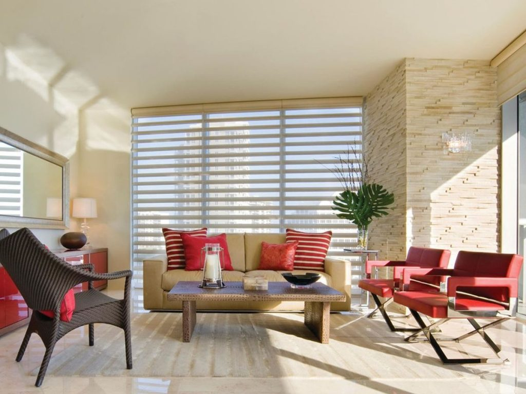 Pleated shades cover a large window.